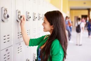 high school student opens school locker
